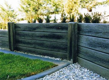 how to build a retaining wall out of concrete sleepers